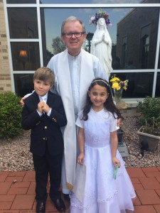 May Crowning 2016 Fr. Mike with Communion children